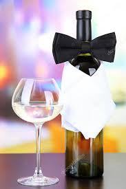wine bottle bow black bow tie on wine bottle on bright background stock photo