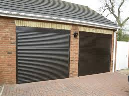 two car garage with brick walls and automatic doors awesome