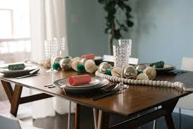 west elm mid century dining table holiday table setting style by melanie blodgett front main