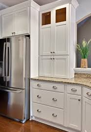 white kitchen cabinets with glass cup pulls bin pulls and knobs vs bar pulls with shaker cabinets