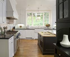 white kitchen with black island black kitchen island transitional kitchen amoroso design
