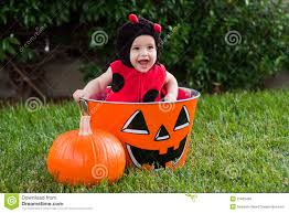 laughing baby in ladybug halloween costume royalty free stock