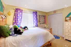 Yellow Baby Room by Yelow Baby Room With Purple Curtains And Yellow Walls Stock Photo