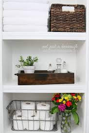 bathroom old fashioned wooden bars bathroom shelves with silver bathroom decorative bathroom shelves with rattan and metal basket also towel and toilet tissues feat