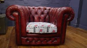 faded distressed age worn red leather chesterfield club chair