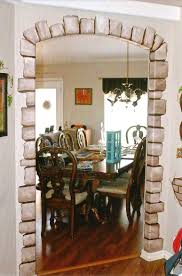 commissioned murals interior exterior personal business house dining room mural painting stones around doorway sections that look like bricks through wall and grape vines around frames