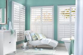white plantation shutters wide louver slats bathroom window