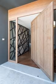 modern wood door designs add a warm welcome