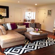 patterned area rug for living room with leather l shaped sofa and