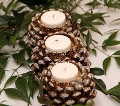 table decorations with pine cones pine cone candle holders centerpiece www tablescapesbydesign com