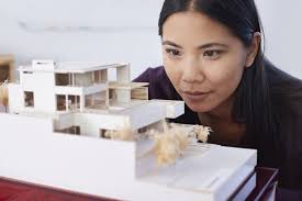 16 women architects who s your favorite a patience young woman excitedly gazing at a built architectural model