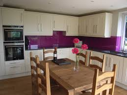 kitchen diner in new extension with purple coloured glass