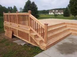 wait for dry weather to stain a new cedar deck doityourself com