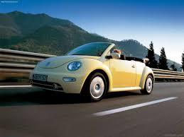 volkswagen bug yellow yellow volkswagen beetle on road car pictures images