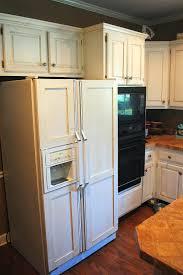 wine storage above refrigerator rack beside fridge cabinet glass