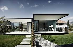the mirror houses a pair of holiday homes in bolzano italy