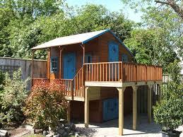 raised playhouse with storage area below grandchildren