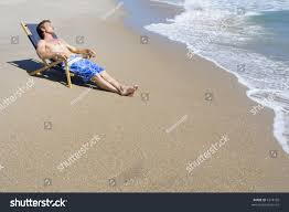 Chairs On A Beach Man Sitting Lounge Chair On Beach Stock Photo 4218139 Shutterstock