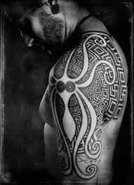 black shoulder tattoo negative space octopus in this neo tribal shoulder tattoo by peter