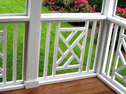 close up of deck with patterned white rail railing options photo