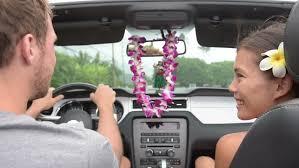 Hawaii travel man images Couple driving car on hawaii travel with hula doll dancing on jpg