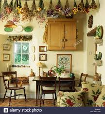 cottage dining room dried flowers on ceiling of small cream cottage dining room with