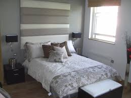 apartment style classic floral bed cover with wooden flooring