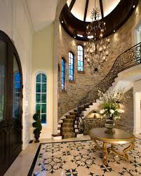 wrought iron stair railing entry traditional with arched windows
