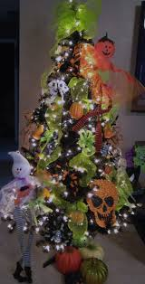happy halloween decorate a black christmas tree with the kidos