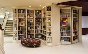 revolving bookcase in basement traditional