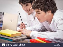 classmates search two classmates doing homework together at home resolving