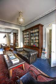regency georgian townhouse uk blue wooden floors bookshelf