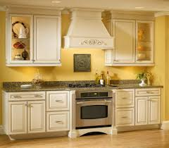 yellow kitchen walls with white cabinets outofhome