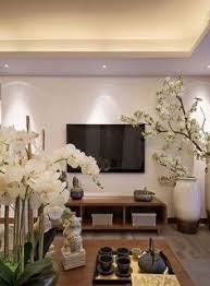 Home Decorating Ideas With An Asian Theme Armoires Plants And - Asian living room design