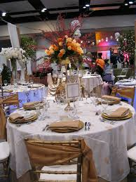 round table with white tablecloth combined by flower bouquet with