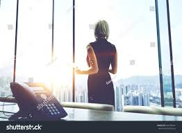 back view businesswoman digital tablet hands stock photo 644198341 back view of a businesswoman with digital tablet in hands is watching in office window on