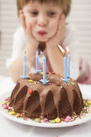 woman blowing out candles on birthday cake royalty free stock