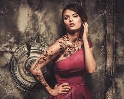 tattooed beautiful woman in old spooky interior u2014 stock photo