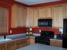 sherwin williams svelte sage with oak cabinets kitchen