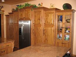 baffling rustic knotty alder kitchen cabinets with rectangle shape