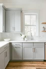 dove grey kitchen cabinets what colour walls a single window in a transitional kitchen surrounds dove