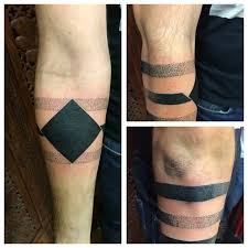 cool solid dotted armband tattoo made with black ink goluputtar com