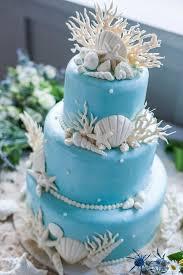 blue wedding white seashell and coral decorated blue wedding cake