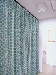 Ceiling Track Curtains Hide A Washer And Dryer With Easy Diy Gathered Laundry Room