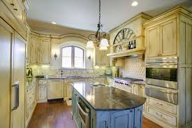 antique white painted kitchen cabinets with a glaze