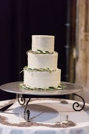 wedding cake simple simple three tiered wedding cake with green leaf garland get