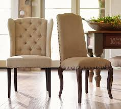 Host Dining Chairs Thayer Tufted Wingback Dining Chair Pottery Barn
