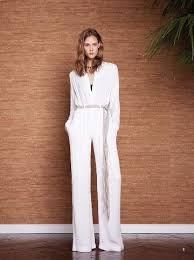 all white jumpsuit a white jumpsuit has 70s written all it l agence