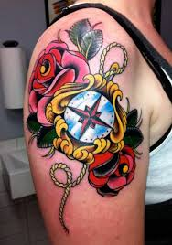 women thigh cover up with outstanding red roses and anchor tattoo