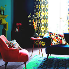 red color schemes for living rooms bold modern living room with blue sofa and red armchair colour
